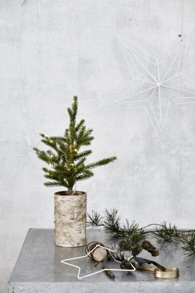 Weihnachtsbaum mit Lämpchen und Holzfuß